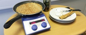 Asynt making pancakes on a hotplate